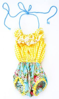 an absolutely adorable baby sunsuit for the summer/ beach from a french designer. okay, i want kids now.