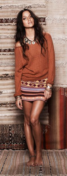 Love this look!  Aztec mini skirt, slouchy top, tan legs! Women's spring fall fashion clothing outfit for dates movies