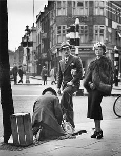 Wolf Suschitzky - Shoe Shine, Charing Cross Road, London, 1936  Silver Gelatin Print - 16 x 20