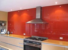 Love me an orange splashback in the kitchen