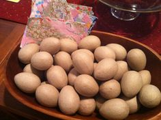 making origami paper-covered eggs for Easter