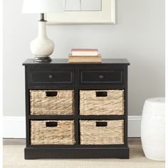This versatile black storage cabinet makes a great bedside table as well as a storage unit. It comes in a black finish that goes well with any color theme, and it has four wicker baskets beneath the drawers to add even more storage space.