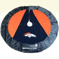 <li>Denver Broncos Official NFL Christmas tree skirt<li>Tree skirt features embroidery stitched logo, team name and colors<li>Football collectible is officially licensed by the league and the team
