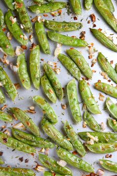 Simply roasted sugar snap peas, this recipe is perfect to serve as a summer side dish to grilled meats.