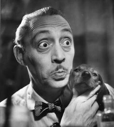 Mischa Auer prepares his face with the help of his dachshund in 1950 Who? Mischa Auer - born Mischa Ounskowsy, was a Russian-. Dachshund Art, Daschund, Miniature Dachshunds, Wtf Face, Puppy Love, Famous People, Cute Dogs, Pop Culture, Best Friends