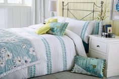 Pretty floral teal bed linen.. So love the bicycle cushion and on my wish list!