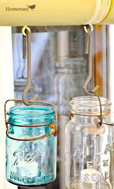 Mason Jar Chandelier Creating a Mason Jar Chandelier from a side of the road find for the patio! Mason Jar Chandelier, Mason Jar Lighting, Mason Jar Lamp, Mason Jar Projects, Tiki Torches, Modern Chandelier, Chandelier Lighting, Funky Junk, Diy On A Budget