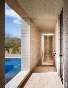 A loggia off the guest quarters of an Arizona home is adjacent to the swimming pool   archdigest.com