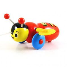 Classic kiwiana toy.  Genuine buzzy bee pull-along from www.ikoiko.co.nz