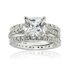 Beautifully stunning, this bridal ring set from Icz Stonez bridal ring set is ready to awe your fiance-to-be. Placed with shimmering 3 1/2 carat cubic zirconia stones, this bridal ring set is a shimmering look for her on the big day.