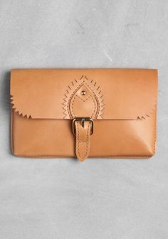 leather clutch or document bag -- interesting decoration