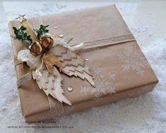 That's Life: Peace On Earth gift wrap inspiration created by Emma Williams for the Tim Holtz Inspiration series