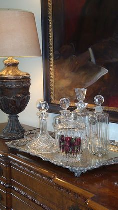 Decanters on silver tray on dining room buffet!