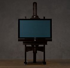What a creative way to display your TV - a free-standing television easel! And, you wouldn't have to drill holes in your wall - genius!