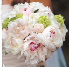 Because Lauren's parents own a flower shop in Westerville, she had free rein in floral design, and the dozens of lush blooms proved to be the highlight of the day. Lauren and her bridesmaid carried soft pink and white peonies.