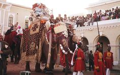 1961 - India: Queen Elizabeth II enjoys an elephant ride at Varanasi during a tour of India.