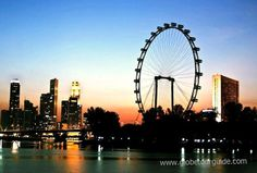 Beautiful view of Singapore city with giant wheel. . . .