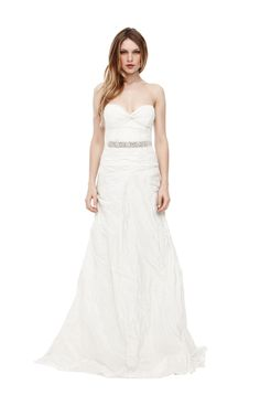Mia Bridal Gown This strapless gown is made of ivory taffeta, a crisp and smooth fabric with a fitted bodice to accentuate the female figure. The classic silhouette has a twist knot neckline and fishtail train. It is the perfect marriage of modern romance and timeless elegance. Belt sold separately.  Color: Ivory. http://www.nicolemiller.com/mia-bridal-gown-9909