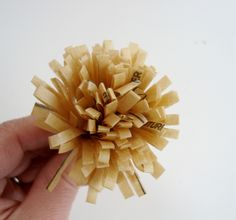 Tissue Paper flower made with sewing pattern pieces and shedder scissors - great tutorial