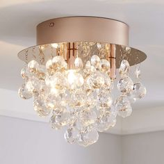 Add a touch of glamour to your home with this lovely Rose Gold ceiling fitting. Featuring clear acrylic ball droplets, this light is sure to add some interest to your home and would suit a range of [ here](https:// to purchase the recommended bulb. Room Decor Bedroom Rose Gold, Rose Gold Rooms, Rose Gold Decor, Bedroom Ideas, Girls Bedroom, White Bedroom, Bedroom Designs, Dream Bedroom, Rose Gold Chandelier