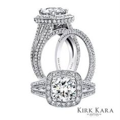 Holy dream engagement and wedding ring!! Diamonds everywhere!!! Cushion cut center diamond with a halo and split shank with a diamond gallery!! *sighhhs of heaven :)