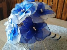 New DIY project for the lovers of handmade products. Flowers from nylon stockings. Colours: navy blue, royal blue and white Royal Blue, Navy Blue, Blue And White, Blue Roses, Handmade Products, Nylon Stockings, Blue Wedding, Wedding Bouquets, Diy Projects