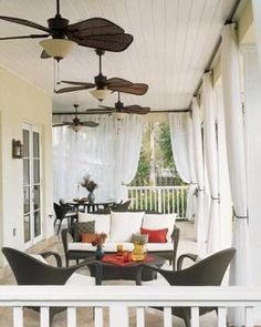 Beautiful porch!! Especially love the ceiling fans and drapes - would be perfect for summer :)