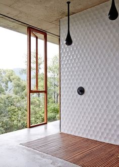 Bathroom Tile Idea - Install 3D Tiles To Add Texture To Your Bathroom | These slightly concave circular tiles have just enough curve to them to keep them from looking flat, and are a nice contrast to the concrete and wood used throughout the rest of the bathroom.