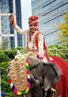 Per Indian tradition, Manish arrived to the ceremony by elephant. #IndianWedding Photography: Tomas Ramos Photographers. Read More: http://www.insideweddings.com/weddings/houston-indian-wedding-celebration-with-800-person-guest-list/435/