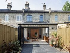 a rear extension on a small terrace house with bi-fold doors to garden