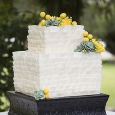 The beautiful flowers and succulents on this cake were made with sugar!