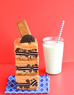The Ultimate Triple Cookie Bar | cookiesandcows.com | A chocolate chip cookie bar with a Biscoff cookie crust, stuffed with an Oreo and topped with a Biscoff Spread buttercream. One simple trick makes these baked cookie bars taste like cookie dough.