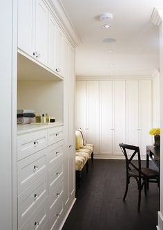 Walk-in closet with built-in storage, bench, and a small desk ~ CASA TRÈS CHIC