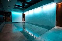Luxury swimming pools, moving floor pools and KLAFS wellness suites from Guncast. Sussex based designers and pool builders also offer London basement pool developments Luxury Swimming Pools, Luxury Pools, Swimming Pool Designs, Moving Walls, Basement Pool, London Townhouse, Pool Builders, Surrey, Relax