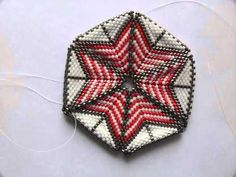 This is Betty Neve's beaded Kaleidocycle. Not too bad for a first attempt and from someone with a bad eye! We were originally inspired by Vi Hart's paper Hex...