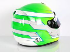 Neon bomb with #blue, #yellow and #green fluor paint. Design your own automobile or kart helmet on https://www.helmade.com/en/helmets/motorsports.html #kart #helmetdesign #racing #motorsport #neon
