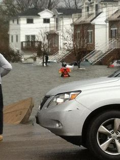 #USCG Sector New York rescue swimmer swimming in the street of Staten Island. #sandy #nyc #sot #military