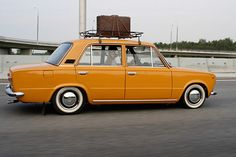 I had to have this picture for 3 reasons: 1. It's ORANGE 2. It's a Datsun 510 (Erica's cruisin' mobile) & 3. It has a bike rack. Too CUTE!!!