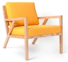 Inspired by the work of the Sarasota School of Architecture and at home in both modern and traditional spaces, this mid-century styled chair features a solid na