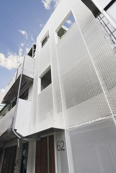KC Design Studio adds perforated facade and atrium to skinny Taiwanese townhouse Studio 24, Design Studio, White Wood Floors, Saint Ouen, High Building, Townhouse Designs, Suburban House, Facade Architecture, Architecture Interiors