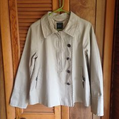 J. Crew 3 way khaki jacket! Size 8, 100% cotton, khaki jacket by J Crew. One of the buttons is chipped otherwise this jacket is in great condition. It can be worn three different ways - as a pullover, open front or 1/2 way zipped down. Unique asymmetrical design. J. Crew Jackets & Coats Utility Jackets