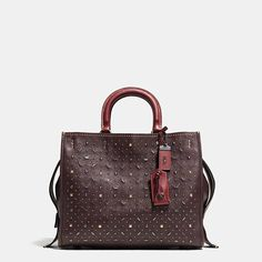 Inspired by the free-spirited Coach girl, the aptly named Rogue is exceptionally well crafted in glovetanned pebble leather with luxe suede linings. Industrial-chic hardware gives it a downtown attitude.