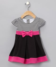 Boasting a splash of stylish stripes and a sweet floral accent at the waist, this party-ready piece can't wait to play! A light, stretchy fabric blend gives it the all-day wearability kids crave.