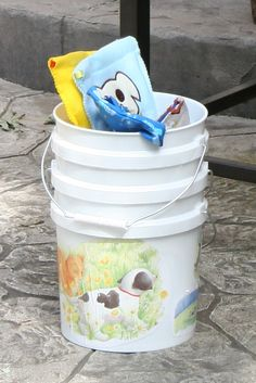 Games: bucket toss - football into buckets with Paw Patrol characters decoupaged on side