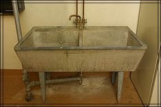 Probably someone came in once a week to do the Purcells' laundry. She would have washed the clothes in this concrete laundry sink with a built-in washboard. Wet clothes were hung in a drying room in another part of the basement. Laundry Tubs, Laundry Storage, Tool Storage, Laundry Rooms, Drying Room, Concrete Sink, Wash Tubs, Utility Sink, Fish House