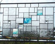 Touch of Blue Stained Glass Panel with gorgeous blue stained glass surrounded by beautiful clear patterned glass and bevels