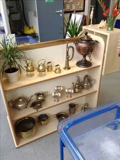 Water play shelf. Change all of your water resources to brass to create a greater sensory experience of the children. The weight, texture, shiny reflective surfaces etc all create more talking and exploring points than the plastic resources, and are a lot more exciting for them to use!