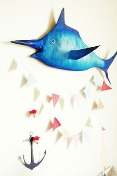 make papier mache fish to decorate the party