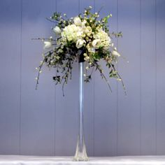 Example of high arrangement with eiffel vase.