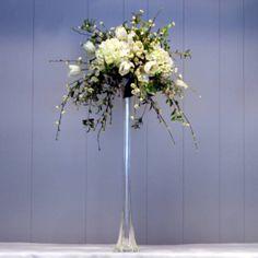 Example of high arrangement with eiffel vase.
